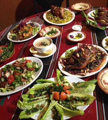 table full of Classic Red Hot Albasha dishes